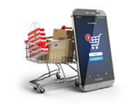 Šoptip - přeplněný košík nákupy a o něj opřené mobilní zařízení využívající k on-line nákupům, Zdroj: shutterstock.com